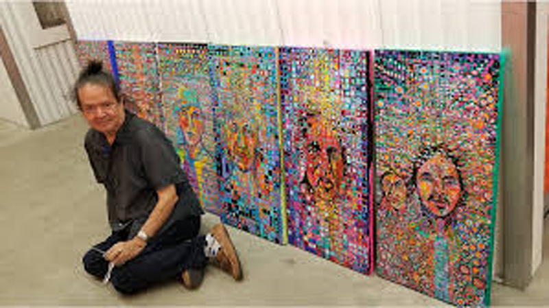 """Norman (k̕wa̱da) James Hall with his piece titled """"Chiefs and Nobles"""""""