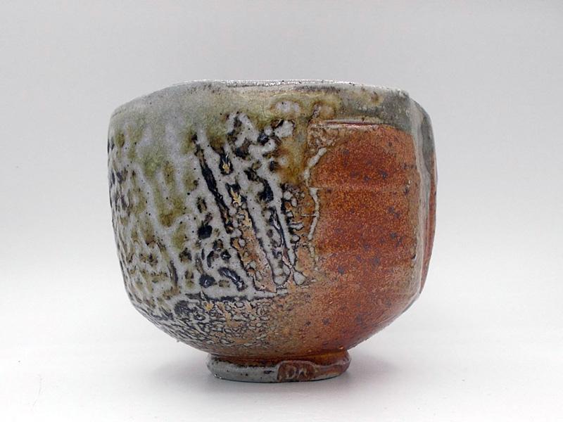 Danny Kostyshin pottery piece, orange, green and gray bowl