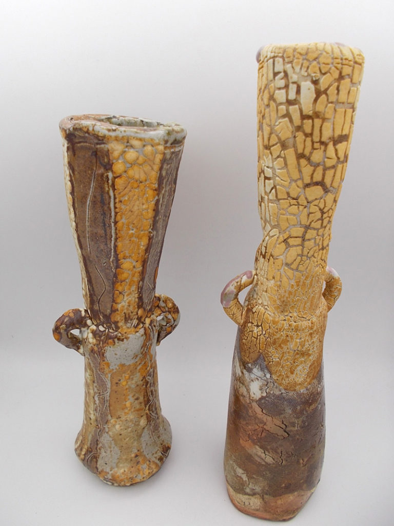 Danny Kostyshin pottery pieces, two gold and brown vases